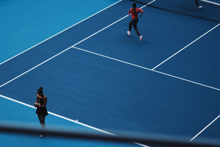 A Couple Playing Tennis