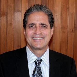 Gregory G. Tennis Coach