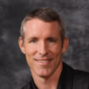 John B. Tennis Coach